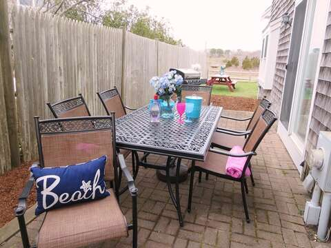 Another dining set is located on the patio with easy access to the kitchen through the sliders - 15 Oyster Drive Chatham Cape Cod New England Vacation Rentals