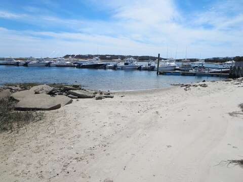 Little Beach at Outermost Harbor at high tide just across the street. Enjoy clamming on the flats across the street at low tide (permit required) - Chatham Cape Cod New England Vacation Rentals Chatham Cape Cod New England Vacation Rentals