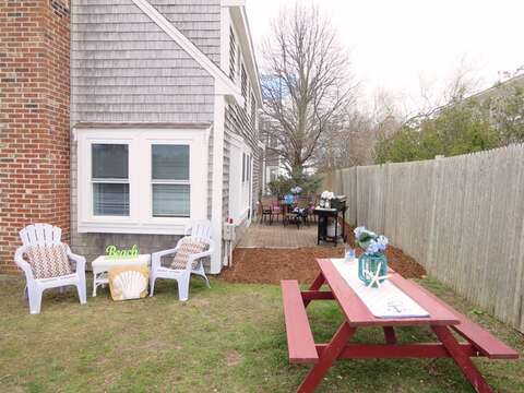 The back yard offers a picnic table and gas grill - 15 Oyster Drive Chatham Cape Cod New England Vacation Rentals