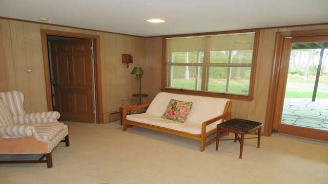sitting area on Lower level - door to washer/Dryer room- Waterfront North Chatham Cape Cod New England Vacation Rentals