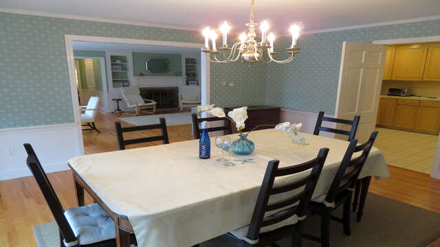 Dining room -easy access from kitchen and open to living room with views- open to sun deck with awning - Waterfront North Chatham Cape Cod New England Vacation Rentals