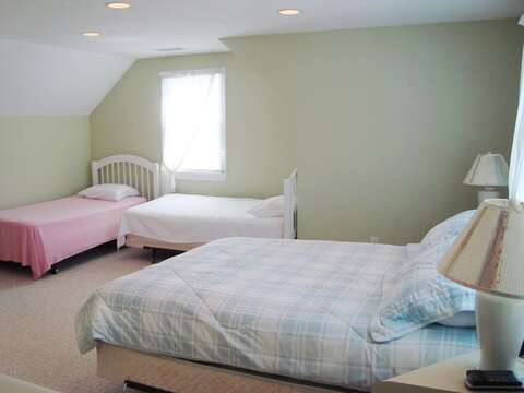 2nd Floor Bedroom #4 with 2 Twins + Queen bed and En suite bath over garage- separate staircase inside of home - 118 Deep Hole Road South Harwich Cape Cod New England Vacation Rentals