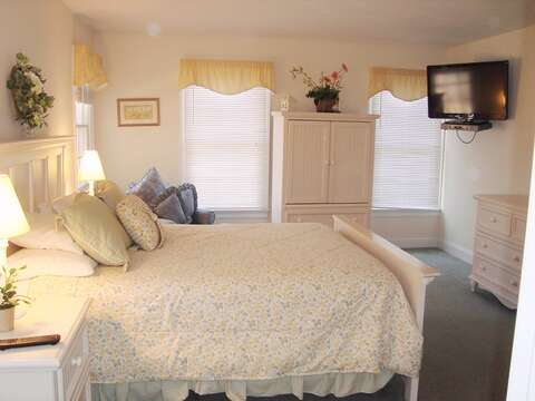 Main Floor Bedroom #1 with Queen Size Bed and TV + En suite Bath - 118 Deep Hole Road South Harwich Cape Cod New England Vacation Rentals