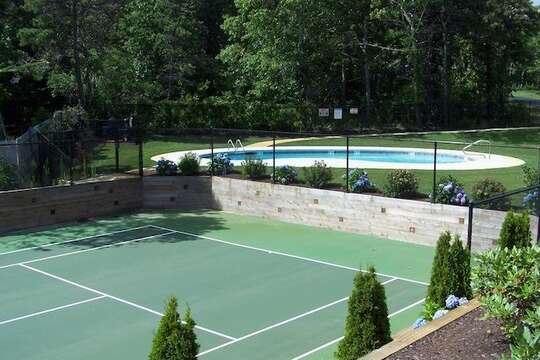 Community Tennis Court with view of pool. Enjoy both of these amenities only 130 steps from the home! - 2 Captains Row E Chatham Cape Cod New England Vacation Rentals