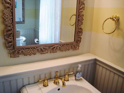 Powder room with washer dryer just off kitchen on 1st floor! 325 Bridge Street Chatham Cape Cod New England Vacation Rentals