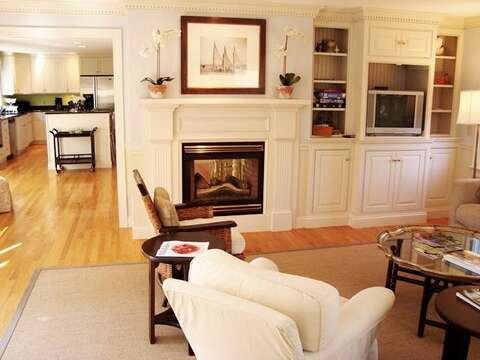 Living Area off Kitchen with gas fireplace- 325 Bridge Street Chatham Cape Cod New England Vacation Rentals