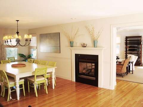 View of dining room with gas fireplace for both rooms - 325 Bridge Street Chatham Cape Cod New England Vacation Rentals