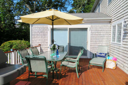 Outdoor deck with table ,chairs Umbrella and gas grill. 118 Deep Hole Road South Harwich Cape Cod New England Vacation Rentals