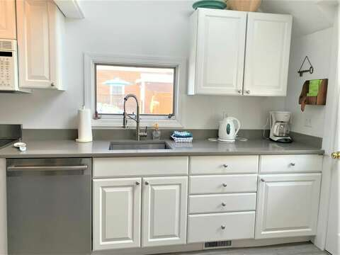 Enter into the newly updated kitchen, with new stainless appliances - 17 Ocean Avenue Harwich Port Cape Cod New England Vacation Rentals