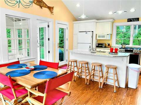 Easy access to both sunroom / porch and deck from the kitchen! 58 Longs Lane Chatham Cape Cod New England Vacation Rentals