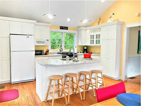 Eating area. Dining table and breakfast bar-Plenty of seating for the entire family- 58 Longs Lane Chatham Cape Cod New England Vacation Rentals