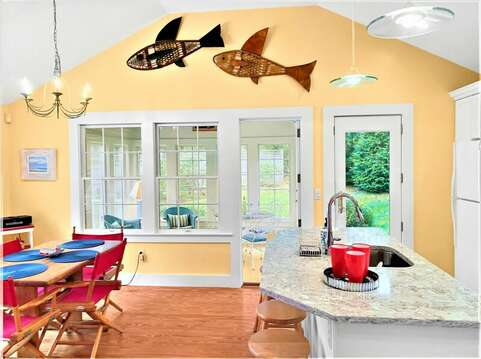 Head through the French doors to the sunroom that leads out to the deck- 58 Longs Lane Chatham Cape Cod New England Vacation Rentals