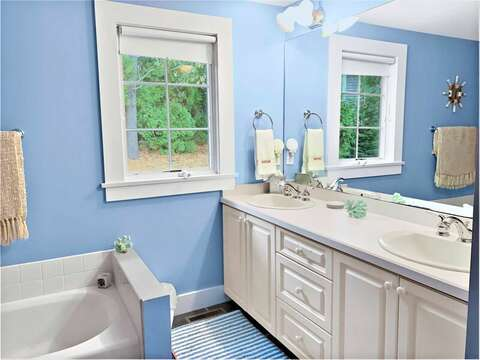 Bathroom 1. Large bathroom with separate bath and shower and double vanity - 58 Longs Lane Chatham Cape Cod New England Vacation Rentals