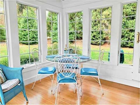 Sunroom with seating and small dining area. Offers easy access to deck - 58 Longs Lane Chatham Cape Cod New England Vacation Rentals