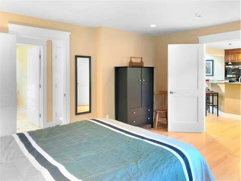 1st floor bedroom with a Queen bed with dual entrances to kitchen and hallway  - 22 Charlene Lane Harwich Cape Cod New England Vacation Rentals
