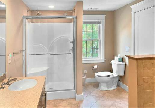 Full bath on the second floor has a double vanity and shower - 22 Charlene Lane Harwich Cape Cod New England Vacation Rentals