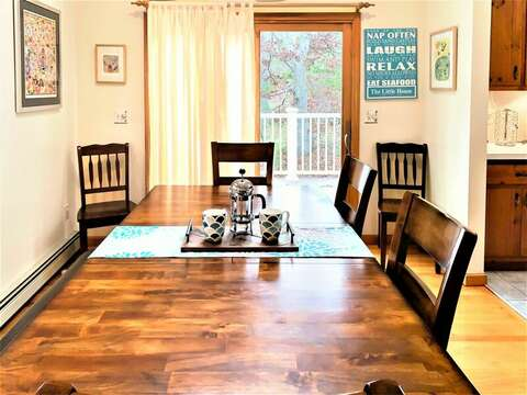 Dining table with slider to deck - 122 Tracy Lane Brewster Cape Cod New England Vacation Rentals