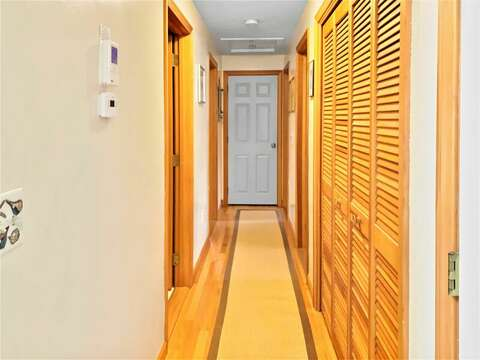 Hallway to bedrooms and full bath grab a game from the game closet for a family night!-122 Tracy Lane Brewster Cape Cod New England Vacation Rentals