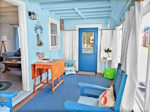Enjoy your favorite book on this porch offering easy access to come and go to the beach from the side door - 17 Ocean Avenue Harwich Port Cape Cod New England Vacation Rentals