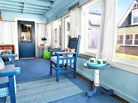 Enjoy your morning coffee on this porch offering easy access to come and go to the beach from the side door - 17 Ocean Avenue Harwich Port Cape Cod New England Vacation Rentals