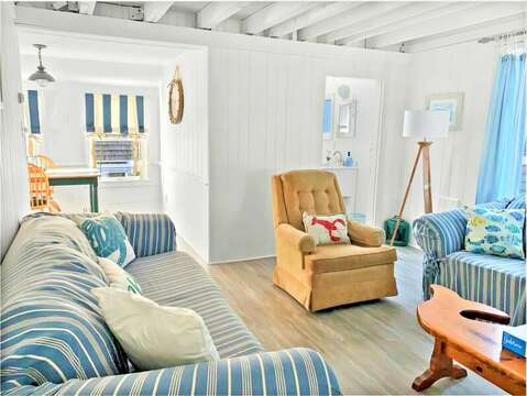 Living room with comfy seating- full bath on the right - 17 Ocean Avenue Harwich Port Cape Cod New England Vacation Rentals