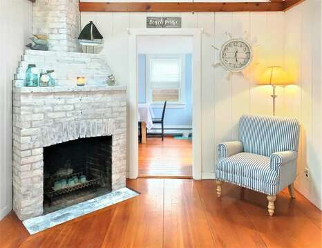 Grab your favorite book and relax in the reading chair by the fireplace (not for guest use) - 130 Belmont Road West Harwich- Cape Cod - New England Vacation Rentals