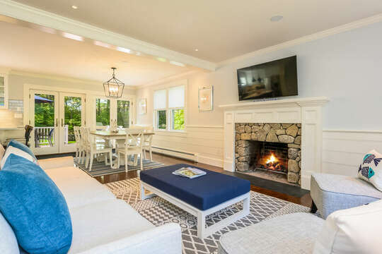 Living room with plenty of seating with flat screen tv opens to dining room-93 Bucks Creek Road Chatham Cape Cod New England Vacation Rentals