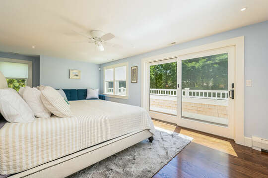 Bedroom #2 King bed sliders to deck overlooking backyard and pool-93 Bucks Creek Road Chatham Cape Cod New England Vacation Rentals