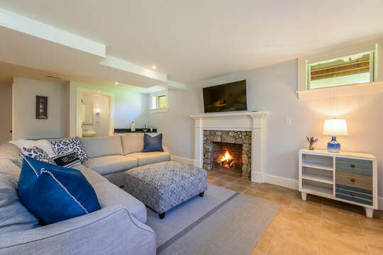 Lower level living room with ample seating , flat screen TV, half bath and game area-93 Bucks Creek Road Chatham Cape Cod New England Vacation Rentals