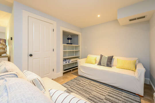Pull out queen sofa for additional  sleeping area in the finished lower level-93 Bucks Creek Road Chatham Cape Cod New England Vacation Rentals