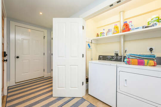 Enter at the lower level into the hall with garage access and washer dryer-93 Bucks Creek Road Chatham Cape Cod New England Vacation Rentals
