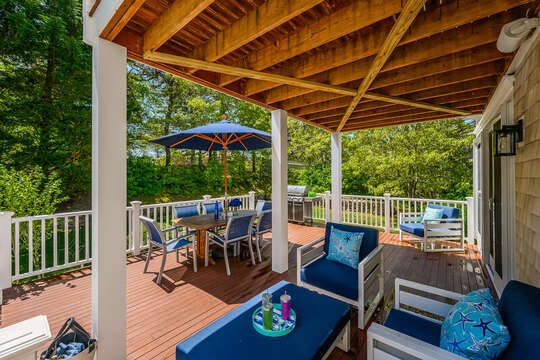 Relax in the comfy chairs on the outside deck at 93 Bucks Creek Road Chatham Cape Cod New England Vacation Rentals