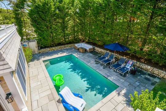 Overview of the pool and relaxing lounge chairs and gas fire pit -93 Bucks Creek Road Chatham Cape Cod New England Vacation Rentals