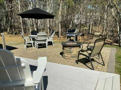 Outdoor living space with gas grill and gas fire pit - 23 Ridgevale Road South Harwich Cape Cod New England Vacation Rentals