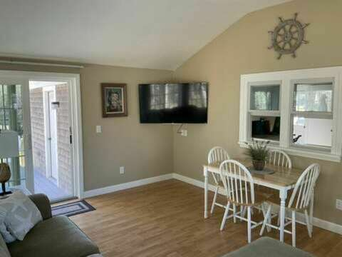 Sunroom with a flat screen smart TV and sliding doors to deck and patio - 23 Ridgevale Road South Harwich Cape Cod New England Vacation Rentals