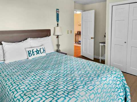 Bedroom 2 on the 1st floor with a Queen bed and sliders to the lower level deck - 19 Bob White Lane South Harwich Cape Cod New England Vacation Rentals