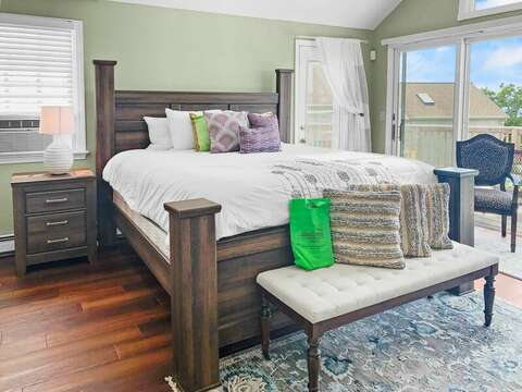 Master suite on the 2nd floor with a King bed, flat screen TV, en suite full bathroom, and sliders to the deck! - 19 Bob White Lane South Harwich Cape Cod New England Vacation Rentals