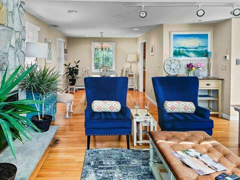 Relax a while at in the new chairs with views of the Ocean, just out of site on the right is a large comfy couch -19 Bob White Lane South Harwich Cape Cod New England Vacation Rentals