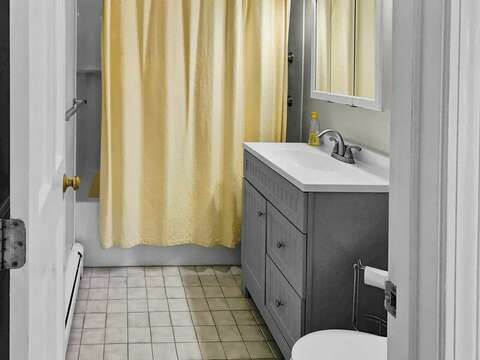 Newly updated bath off of the hallway on the 1st floor with a tub and shower - 19 Bob White Lane South Harwich Cape Cod New England Vacation Rentals