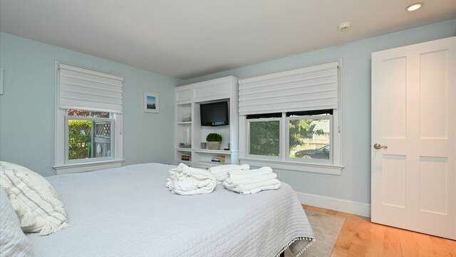Main Floor Bedroom #1 with Flat Screen TV. 201 Main Street Chatham Cape Cod New England Vacation Rentals