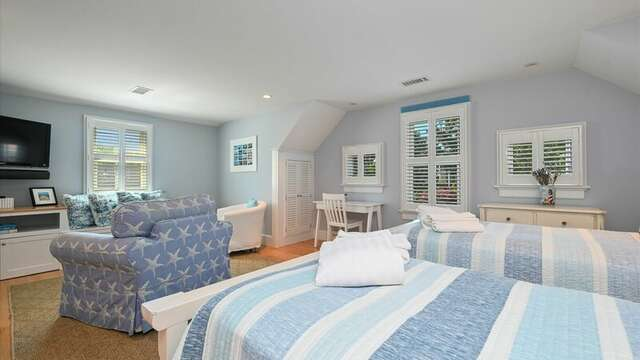 Upstairs Bedroom #3 with 2 Twin Beds, Flat Screen TV and  On Suite Bathroom #3 JacknJill Bath that has shower and tub. 201 Main Street Chatham Cape Cod New England Vacation Rentals