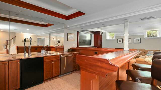 Lower Level Game/Media/Exercise Area with Bar, Comfy Seating, Pool Table, Large TV.  201 Main Street Chatham Cape Cod New England Vacation Rentals
