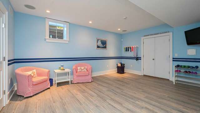 Lower Level Exercise Area with Bar, Comfy Seating, Pool Table, Large TV.  201 Main Street Chatham Cape Cod New England Vacation Rentals