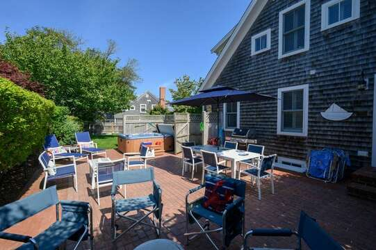 Spacious Patio wit lots of seating, Firepit, Dining and Hot Tub.  201 Main Street Chatham Cape Cod New England Vacation Rentals