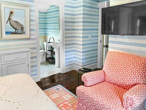 Bedroom 1 has an en suite bathroom with a shower and a flat screen tv - 32 Bearses By Way Chatham Cape Cod New England Vacation Rentals
