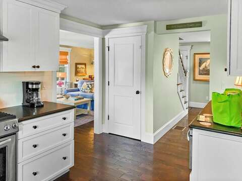 view from the Kitchen which opens to the dining room and Living room- 32 Bearses By Way Chatham Cape Cod New England Vacation Rentals