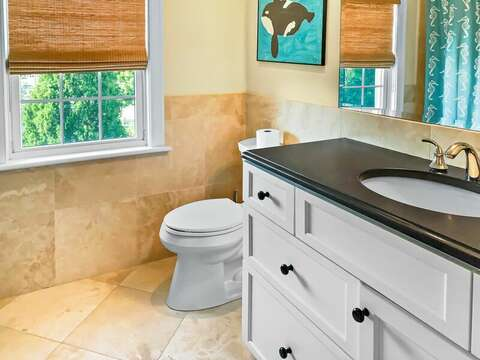 Full bathroom with a tub and shower on the 2nd floor off of the hallway - 32 Bearses By Way Chatham Cape Cod New England Vacation Rentals
