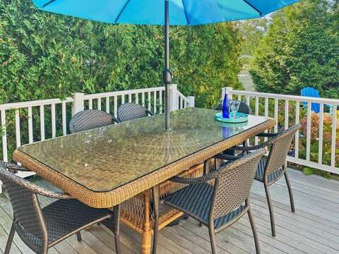 Deck with outdoor furniture, umbrellas for shade, and a gas grill - 32 Bearses By Way Chatham Cape Cod New England Vacation Rentals