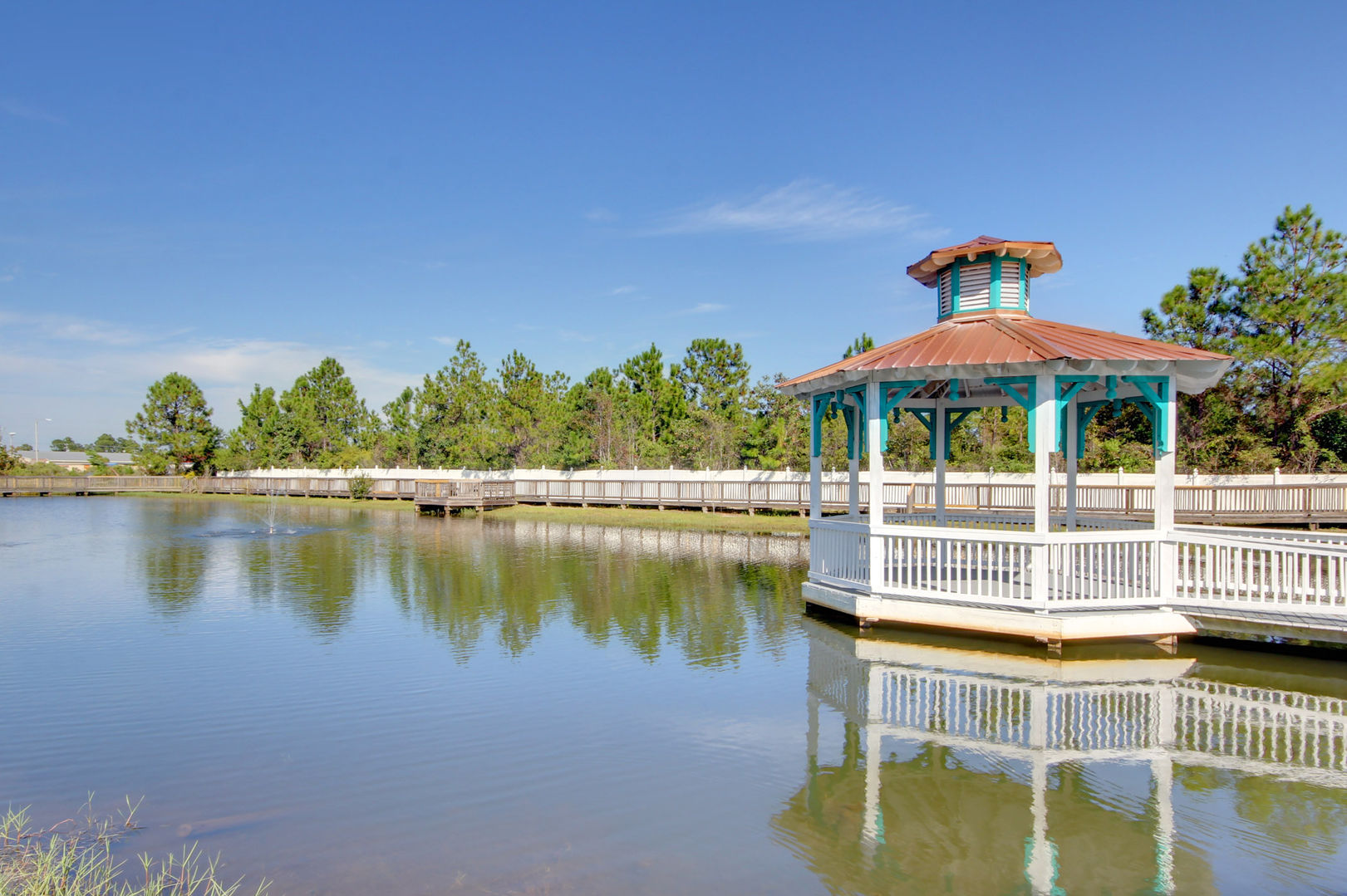 Experience a Gulf Coast sunset from this dock overlooking the lake.
