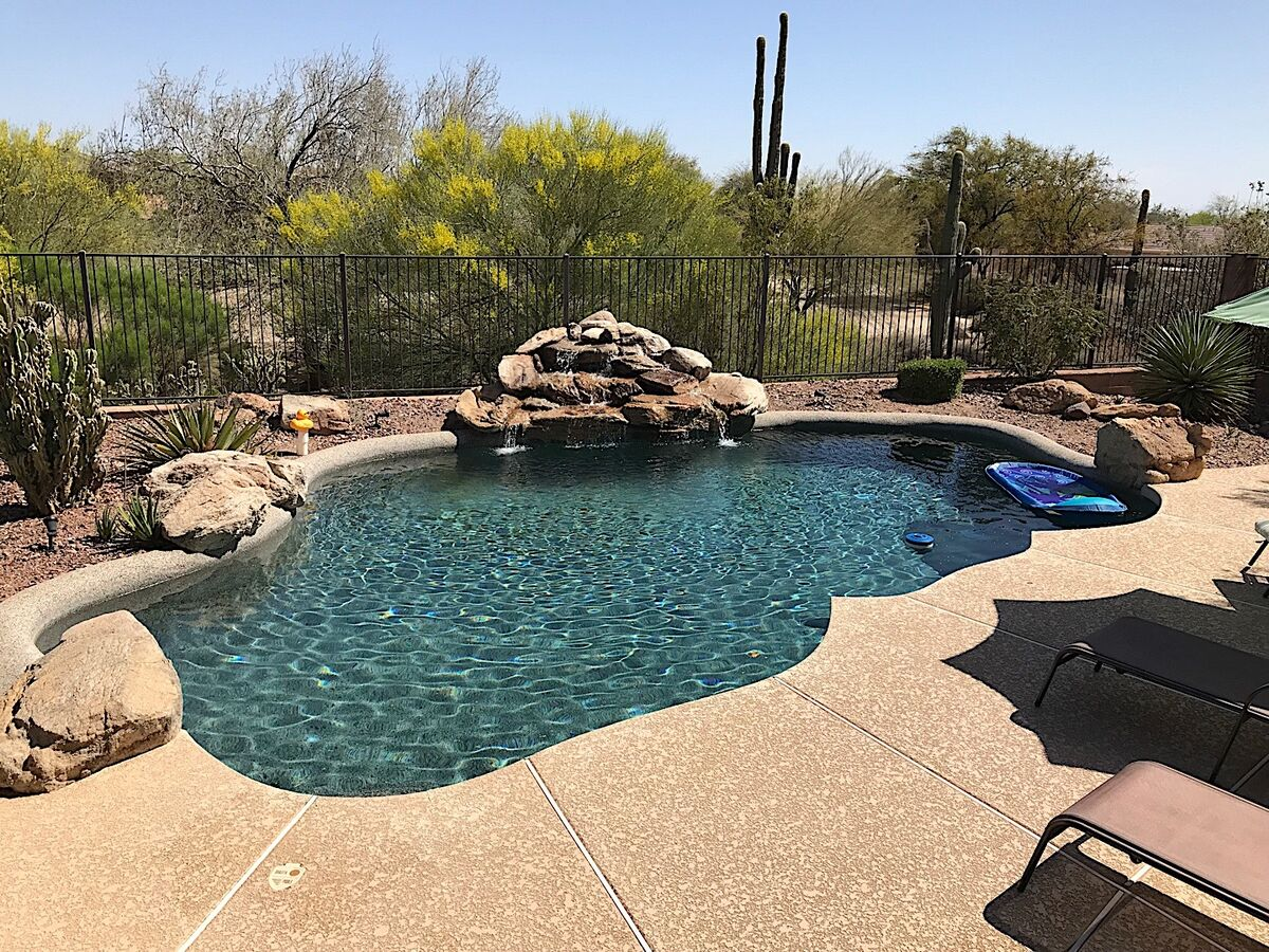 Pool area with golf course view